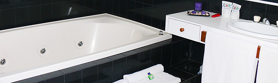 Huge 2 person spa bath with separate shower.